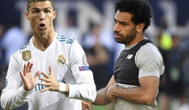 Cristiano Ronaldo, del Real Madrid, y Mohamed Salah, del Liverpool / AFP