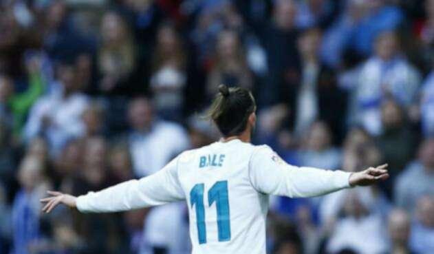 Gareth Bale celebrando uno de sus goles ante Celta de Vigo, en el estadio Santiago Bernabéu de Madrid