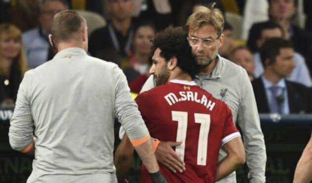 Jürgen Klopp y Mohamed Salah / AFP