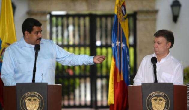 Los presidente Nicolás Maduro y Juan Manuel Santos / AFP