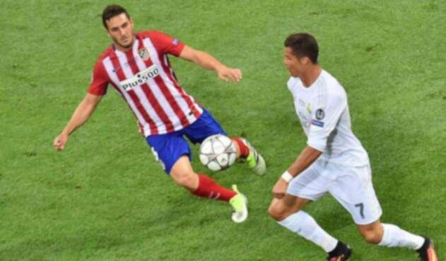 Koke contra Crisiano en un partido entre el Atlético y el Madrid