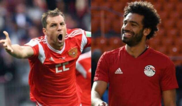 Artem Dzyuba, delantero de Rusia y Mohamed Salah, delantero de Egipto