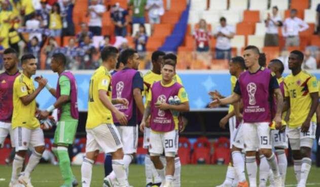 Jugadores de la Selección Colombia tras el partido ante Japón
