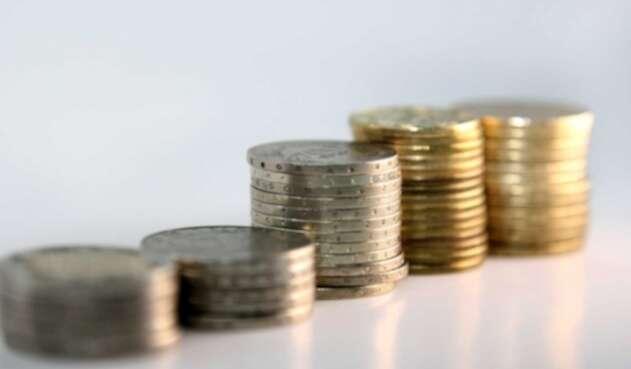 Pago multa de $540.000 con monedas de $50