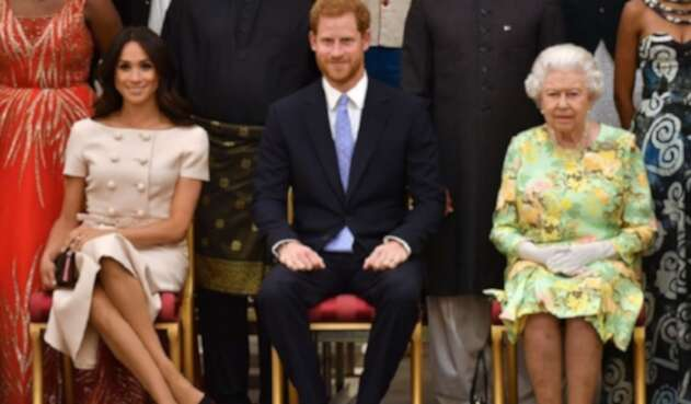 Reina Isabel II, príncipe Harry y Meghan Markle