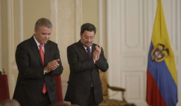 Iván Duque junto a Francisco Santos.