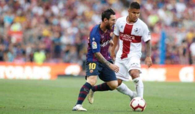 Lionel Messi y Juan Camilo Hernández, el 'Cucho', en el Barcelona vs Huesca, en el Camp Nou