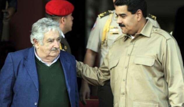 José 'Pepe'Mujica y Nicolás Maduro.