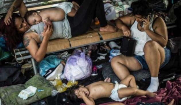 Niños caravana migrantes hondureños