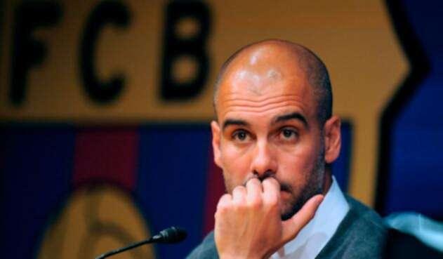 Pep Guardiola en sus épocas como técnico del FC Barcelona