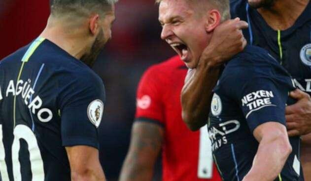 Jugadores del Manchester City celebran una victoria en la Premier League