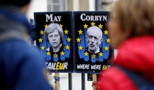 Imágenes de Theresa May y el líder opositor Jeremy Corbyn.