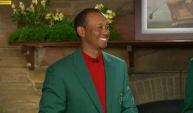 Tiger Woods con la chaqueta verde de campeón del Masters de Augusta