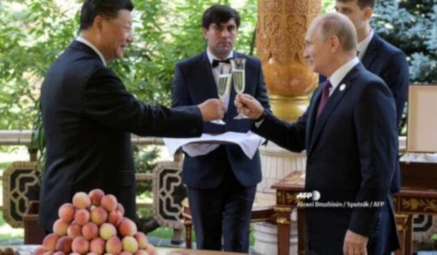 Vladimir Putin y Xi Junping