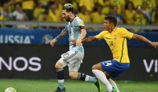Messi y Thiago Silva