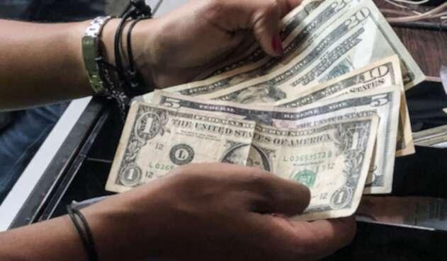 Dólares y tasa de cambio