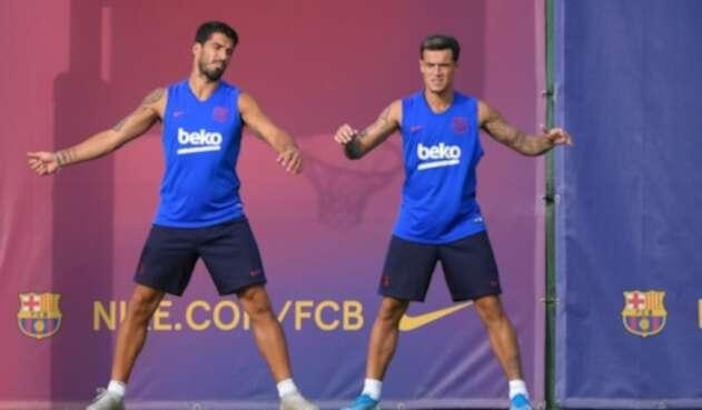 Suárez y Coutinho en un entrenamiento con el FC Barcelona