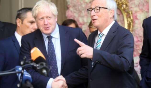 Primer ministro británico, Boris Johnson, con el presidente de la Comisión Europea, Jean-Claude Juncker