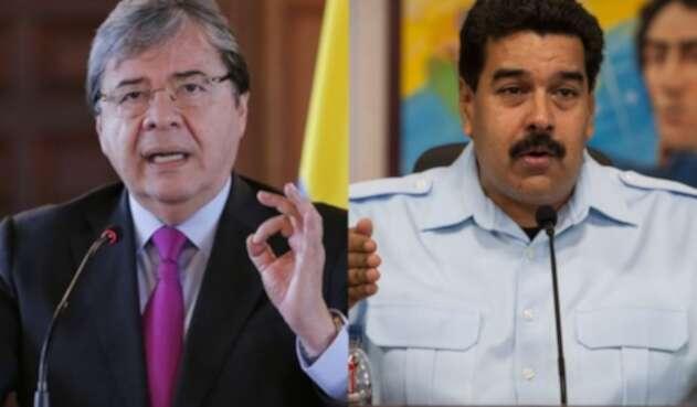 Carlos Holmes Trujillo y Nicolás Maduro