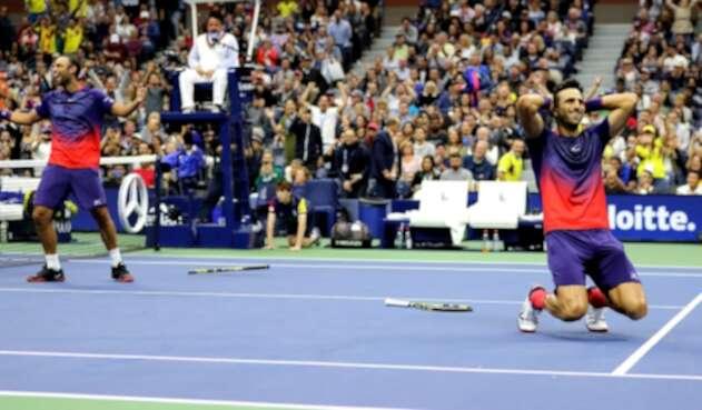 Juan Sebastián Cabal y Robert Farah luego del ganar el Us Open 2019, el 6 de septiembre de 2019 en Nueva York (Estados Unidos)