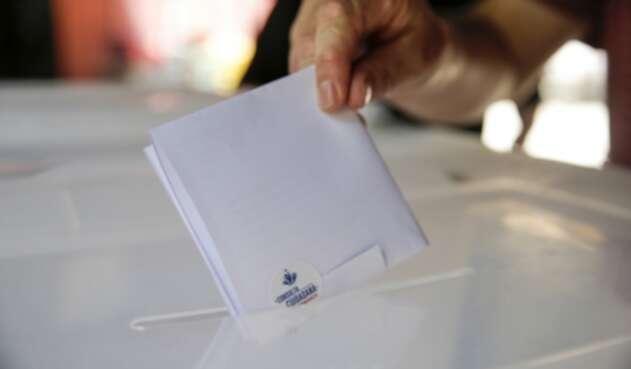 Chilenos en votación