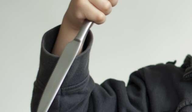 Niño con cuchillo