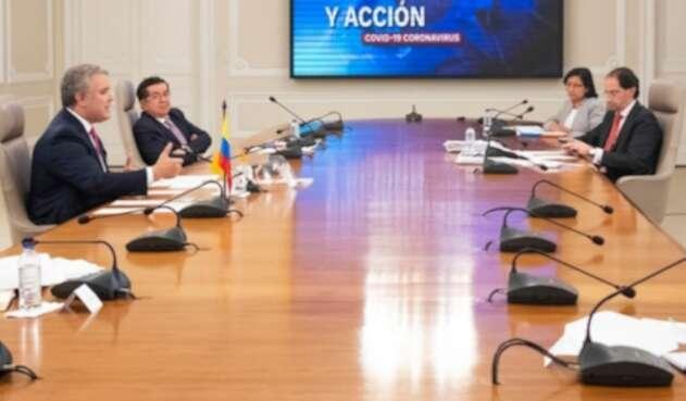 Ivan Duque y José Manuel Restrepo, ministro de Comercio