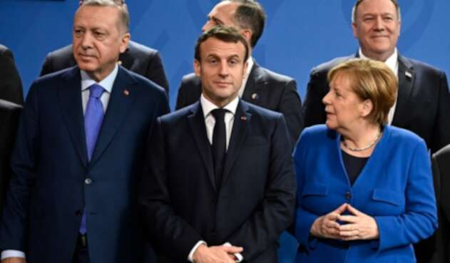 Recep Tayyip Erdogan, Emmanuel Macron y Angela Merkel